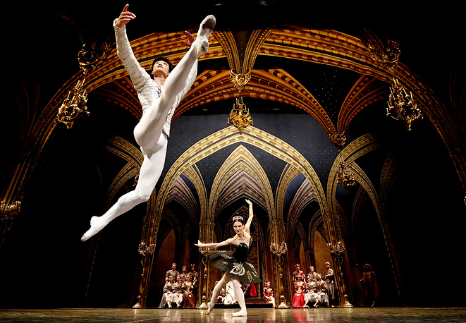 Dancers Kimin Kim and Yulia Stepanova of the St Petersburg Ballet perform Swan Lake during a photo call at the Coliseum theatre in London, August 21