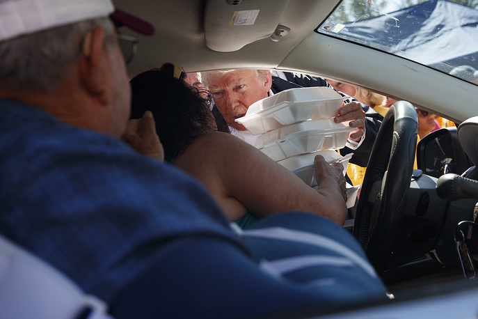 US President Donald Trump hands out food at Temple Baptist Church, where supplies are being distributed for the Hurricane Florence recovery efforts, in New Bern, North Carolina, USA, September 19