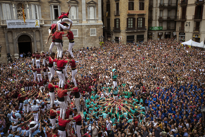 "Participants make human towers or ""Castellers"" during the Saint Merce celebrations in San Jaime square in Barcelona"