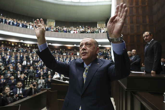 Turkey's President Recep Tayyip Erdogan waves to members of his ruling Justice and Development Party, after addressing them at the parliament in Ankara, October 23. On October 20, Saudi authorities announced that Saudi journalist Jamal Khashoggi was killed in its Istanbul consulate. Erdogan demanded that the kingdom reveal the identities of all those involved, regardless of rank