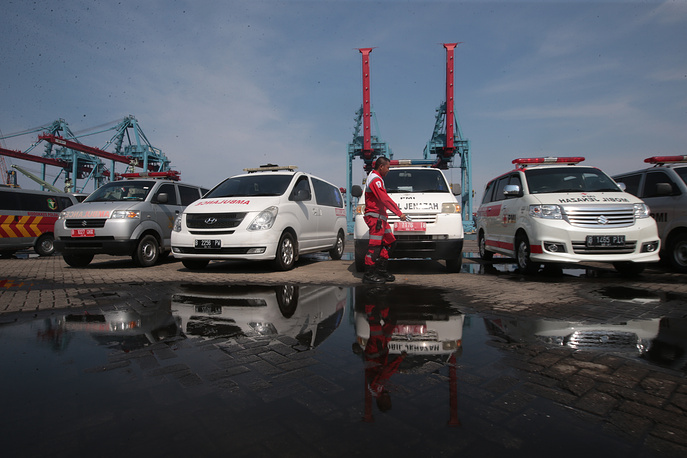 Indonesian rescue team members prepare ambulances at Tanjung Priok Harbour