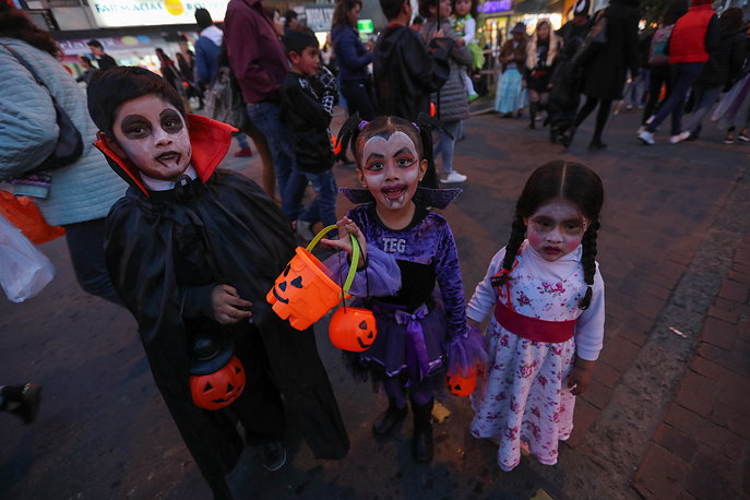 Bolivian youth and children participate in the Halloween party in La Paz