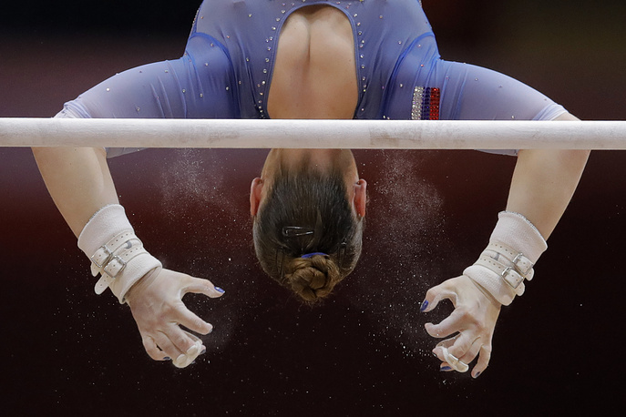 Russia's Aliia Mustafina performs on the uneven bars during the women's team final of the Gymnastics World Chamionships at the Aspire Dome in Doha, Qatar, October 30