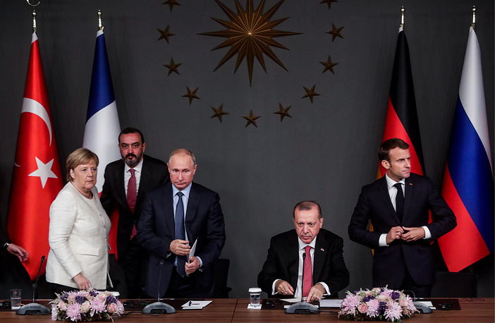Germany's Chancellor Angela Merkel, Russia's President Vladimir Putin, Turkey's President Recep Tayyip Erdogan and France's President Emmanuel Macron during a press conference following a summit to discuss the situation in Syria, Istanbul, October 27