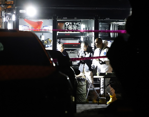 Investigators wearing hazmat outfits work out of the command center at the Borderline Bar and Grill in Thousand Oaks