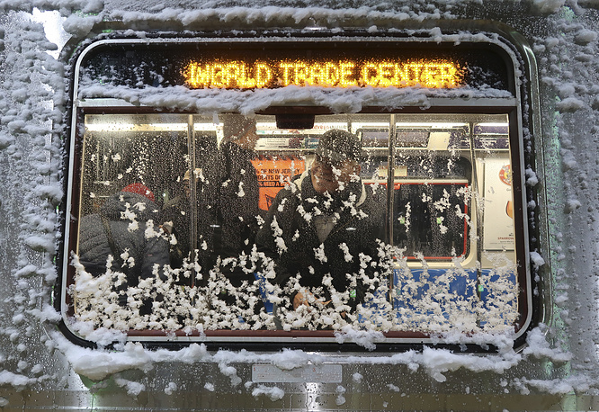 A World Trade Center bound PATH train is covered in snow as it sits in Newark Penn Station in Newark, November 15