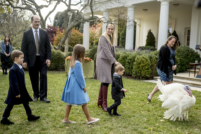 Ivanka Trump, the daughter of President Donald Trump, with her children, and Peas, one of the two National Thanksgiving Turkeys