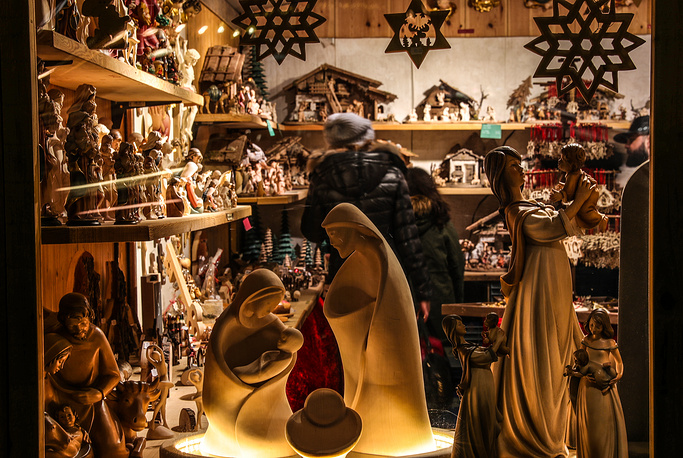 People shop for festive ornaments at the Christmas market in Frankfurt am Main, Germany