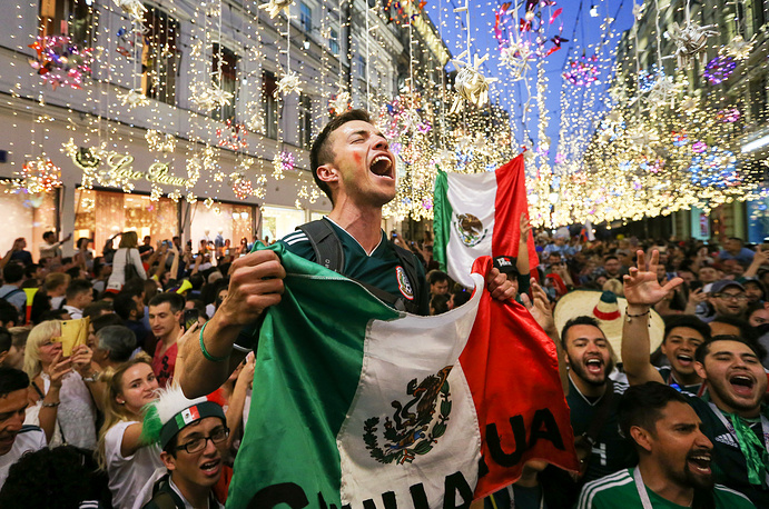 Mexican football fans gather in Nikolskaya Street in central Moscow to celebrate Mexico's victory in a 2018 FIFA World Cup First Stage Group F match against Germany