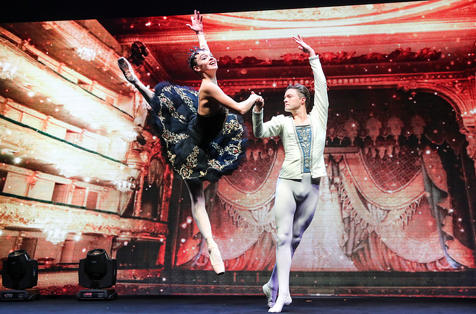 Mariinsky Theatre's second soloist Tatyana Tkachenko and Mikhailovsky Theatre principal Mikhail Sivakov perform at the opening of the 2018 FIDE World Rapid and Blitz Chess Championships at St Petersburg's Manezh Central Exhibition Hall, December 25