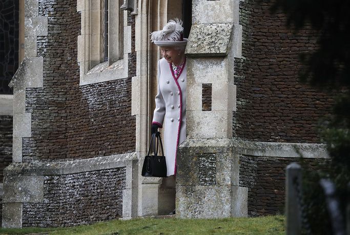 Britain's Queen Elizabeth II leaves after attending the Christmas day service at St Mary Magdalene Church in Sandringham in Norfolk, December 25