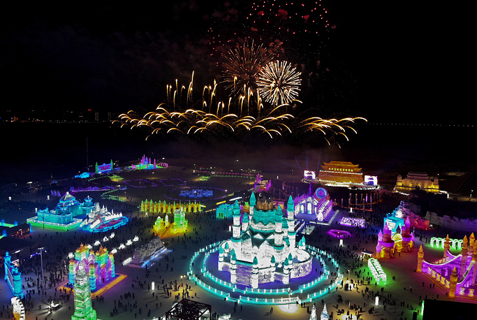 Fireworks explode over ice sculptures during the opening of the annual Harbin International Ice and Snow Festival in Harbin in China
