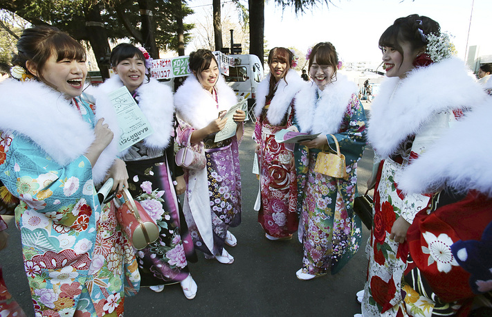 Kimono-clad 20-year-old Japanese women pose for a group photograph in Tokyo