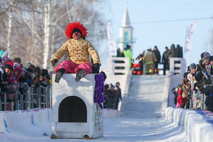 Participants ride the sledges they have designed for the SunnyFest artistic sledge festival in Mamadysh, Russia, January 26