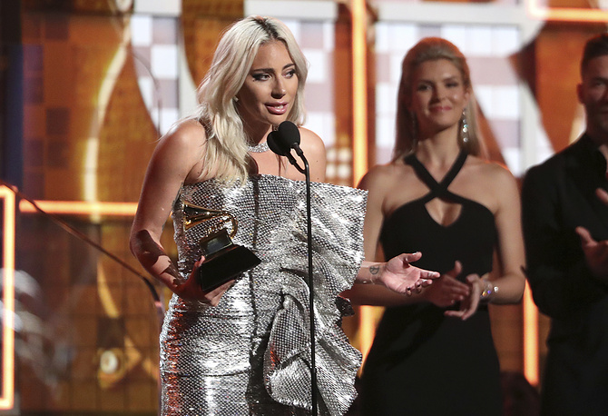 """Lady Gaga accept the award for best pop duo or group performance for """"Shallow"""" at the 61st annual Grammy Awards in Los Angeles"""