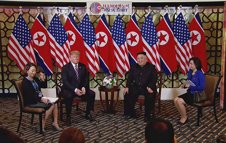 US President Donald J. Trump and North Korean leader Kim Jong-un sit with interpreters during the second US-North Korea summit in Hanoi