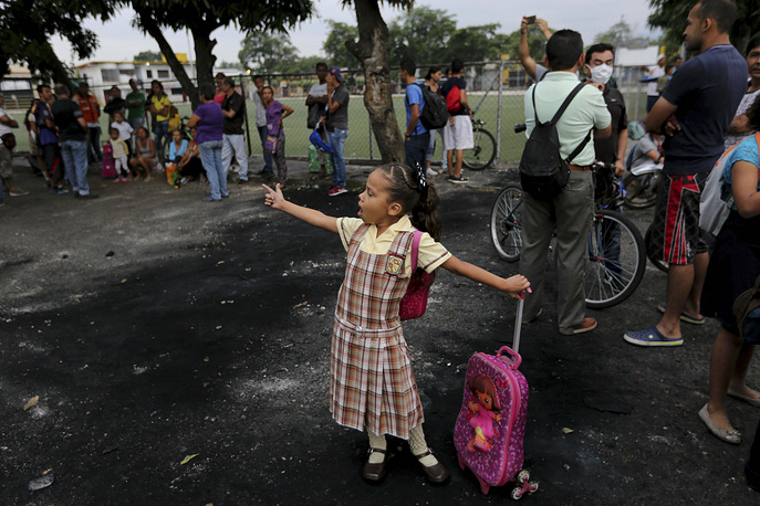 A girl who studies in Cucuta, Colombia, points to the Francisco de Paula Santander international bridge, closed by the Venezuelan Bolivarian National Guard, in Urena, Venezuela, February 26. Venezuelan children, who attend school on the Colombian side of the border, have been blocked from class after the border between both countries was closed by the Venezuelan government