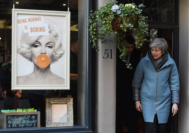 Britain's Prime Minister Theresa May leaves Smith England hairdresser salon during a visit to Salisbury, March 4. May visited the historic city of Salisbury one year after the Novichok attack on former Russian spy Sergei Skripal and his daughter Yulia