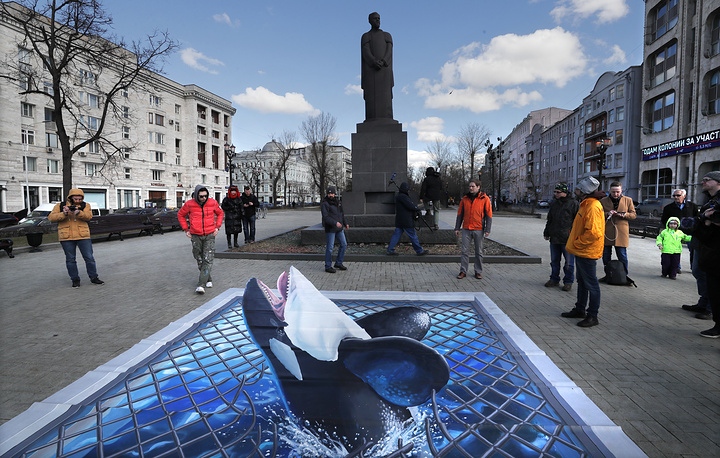 Greenpeace activists staging a rally demanding the release of illegally caught orcas and beluga whales from the so-called 'whale prisons' off the coast of Russia, in Moscow, April 2. Cubs of these cetaceans were illegally caught in the Sea of Okhotsk in the summer of 2018 and are reportedly still kept in enclosures at bay Srednyaya in Primorsky Krai