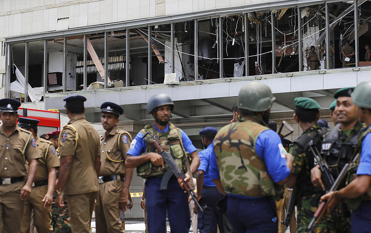 Police and security personnel standing gaurd after an explosion hit Shangri-La Hotel in Colombo