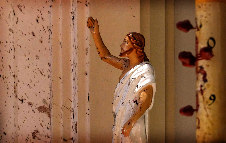 Blood stains are seen on a statue of Jesus Christ at St. Sebastian Catholic Church after a blast in Negombo, Sri Lanka, April 21