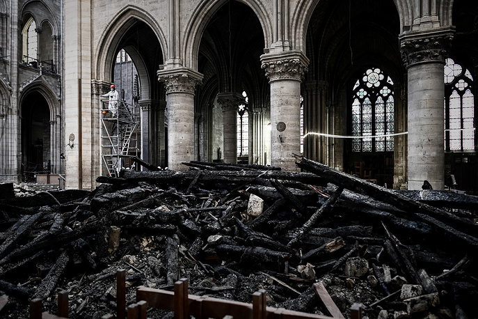 The Notre Dame Cathedral's iconic spire and most of the roof collapsed in the fire