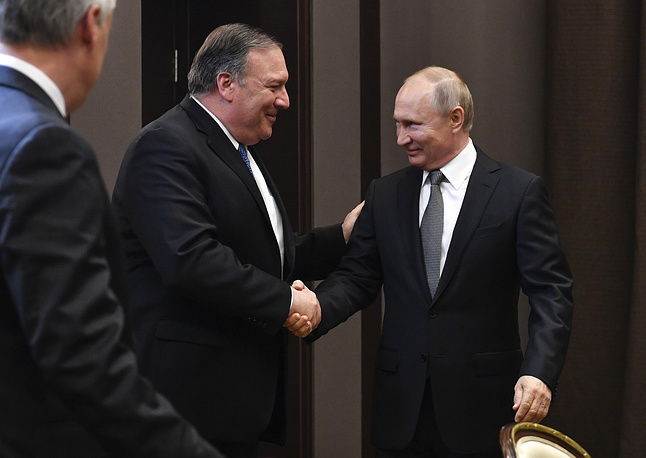 US Secretary of State Mike Pompeo and Russian President Vladimir Putin greeting each other prior to their talks in the Black Sea resort city of Sochi, May 14