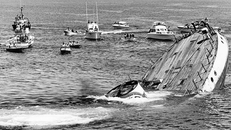 Ceremonial sinking of the Rainbow Warrio. Restoration after explosions was deemed unfeasible, 1987