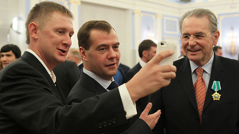 Dmitry Medvedev and former IOC president Jacques Rogge (right)