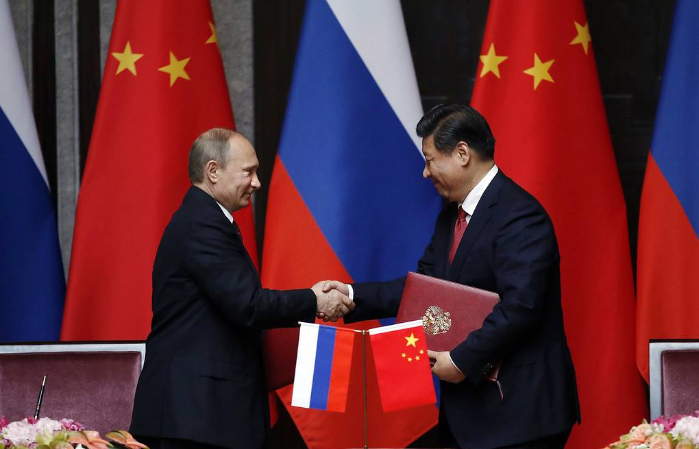 Vladimir Putin and Xi Jinping AP Photo/Carlos Barria, Pool