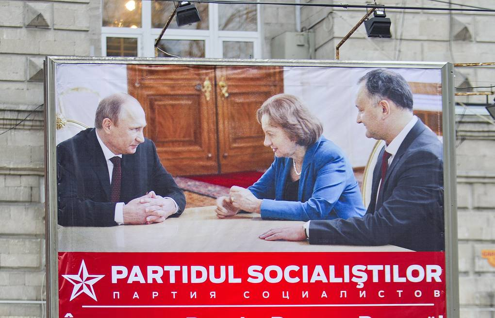 Electoral poster of the Socialist Party of Moldova with Vladimir Putin and Igor Dodon pictured on it EPA/DUMITRU DORU