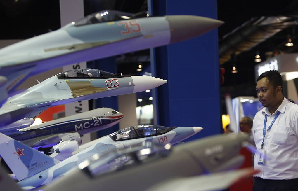 Model planes at the Sukhoi booth at the Changi Exhibition Centre EPA/WALLACE WOON