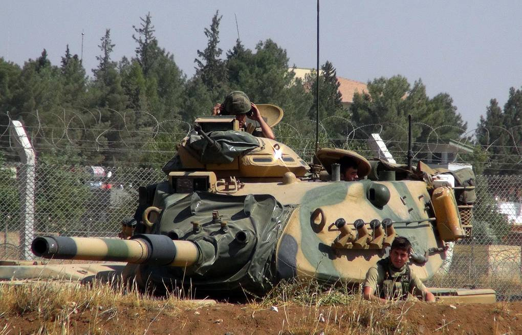 Turkish army tank stationed near the Syrian border AP Photo