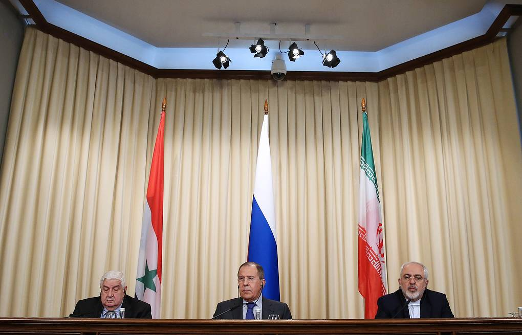 Syrian, Russian and Iranian foreign ministers, Walid Muallem, Sergey Lavrov and Mohammad Javad Zarif  Anton Novoderezhkin/TASS
