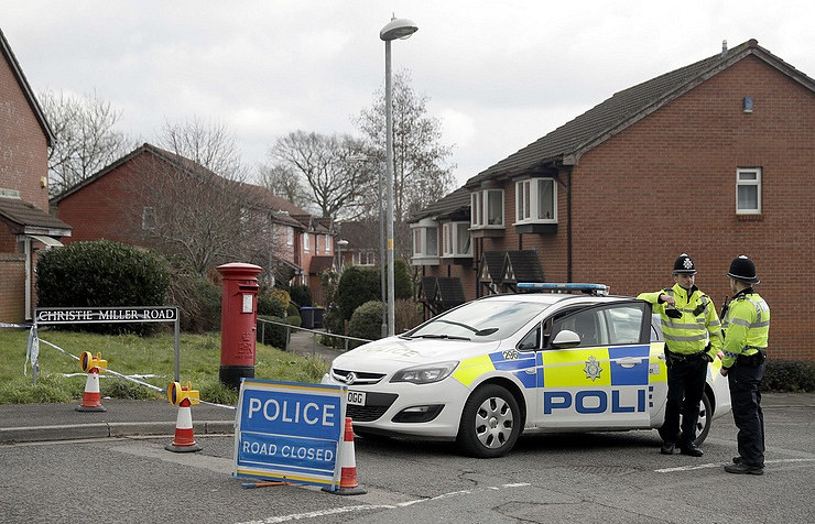 Police officers stand guard near the house of Sergei Skripal in Salisbury, England AP Photo/Matt Dunham