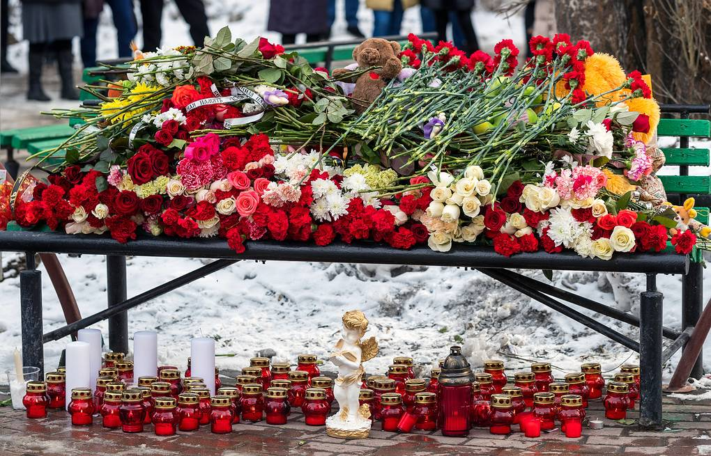 Flowers, candles and toys outside the Zimnyaya Vishnya shopping centre where over 60 people were killed in fire  Danil Aikin/TASS