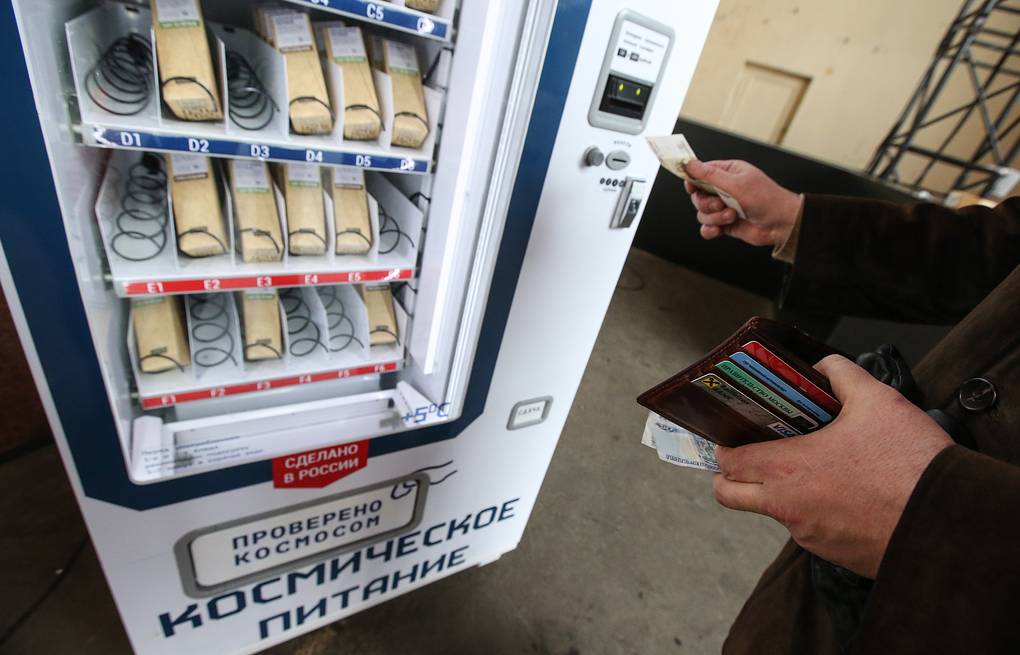 A man inserts money in a vending machine in Moscow to buy space food in tubes that is used by austronauts in space  Vyacheslav Prokofyev/TASS