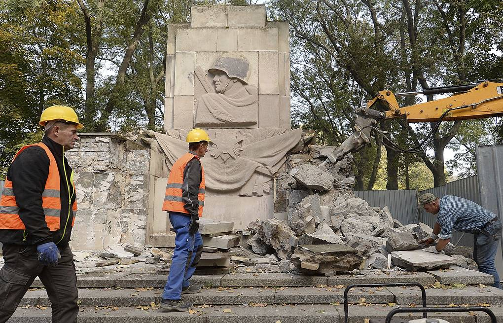 Heavy equipment taking apart a communist era monument in Warsaw AP Photo/Czarek Sokolowski