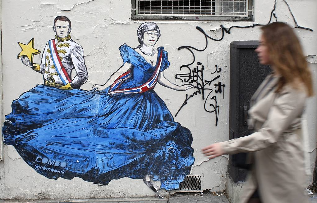 Graffiti by French artist Combo depicting France's President Emmanuel Macron and British Prime Minister Theresa May in Paris AP Photo/Thibault Camus