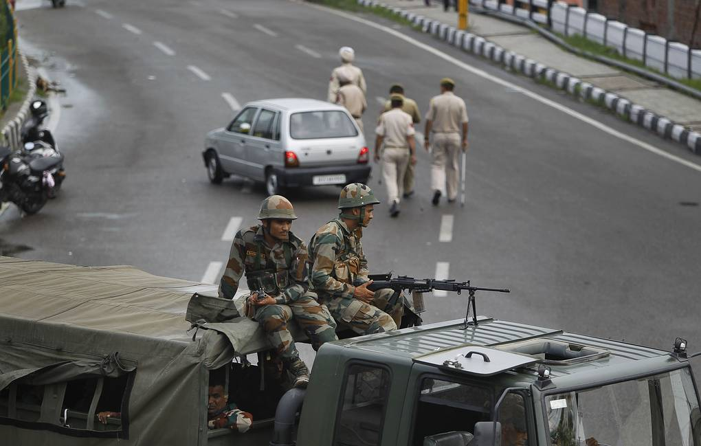 Indian army soldiers guarding during restrictions in Jammu, India AP Photo/Channi Anand