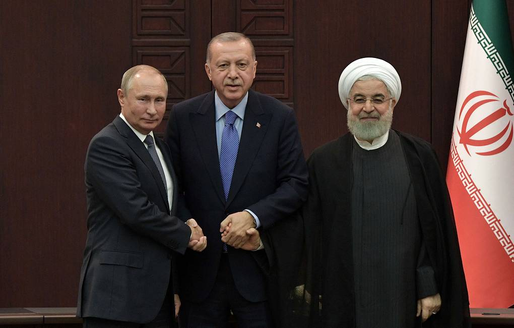 Russia's President Vladimir Putin, Turkey's President Recep Tayyip Erdogan, and Iran's President Hassan Rouhani (L-R) after a joint press conference following the 5th trilateral summit to discuss prospects for Syrian peace process Alexei Nikolsky/Russian Presidential Press and Information Office/TASS