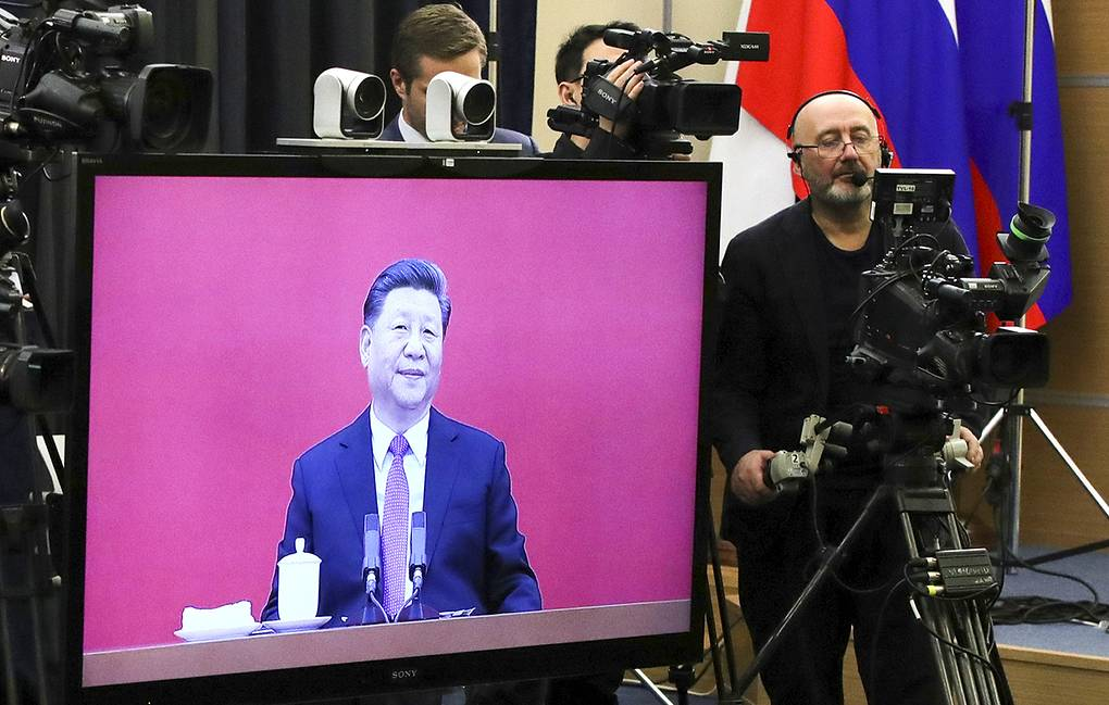 Chinese President Xi Jinping seen on a TV screen during the launch of the Power of Siberia gas pipeline Mikhail Klimentyev, Sputnik, Kremlin Pool Photo via AP