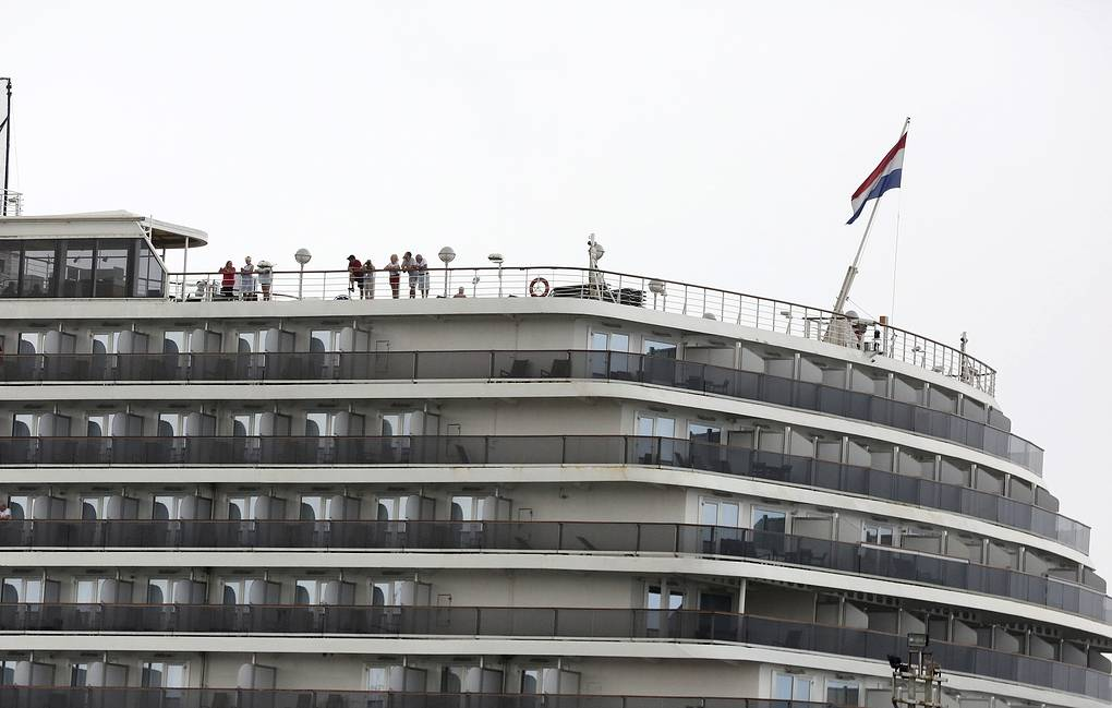 Passengers are seen on the top deck of the Westerdam cruise ship docked in Sihanoukville, Cambodia AP Photo