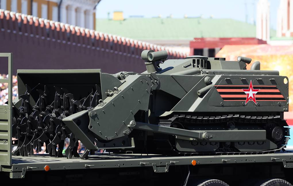 A KamAZ-65117 military truck carrying an Uran-6 mine-clearing robotic system rolls down Moscow's Red Square during a parade marking the 73rd anniversary of victory over Nazi Germany in World War II Sergei Bobylev/TASS