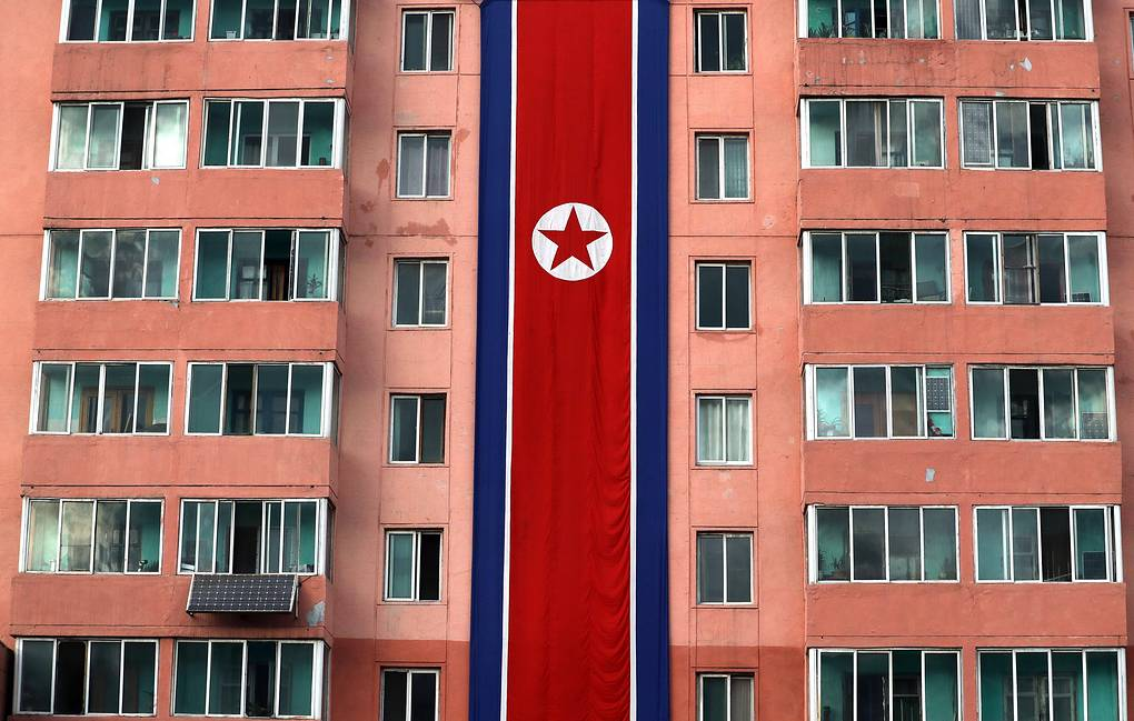 The North Korean national flag on the facade of a residential building in the city of Pyongyang Alexander Demyanchuk/TASS