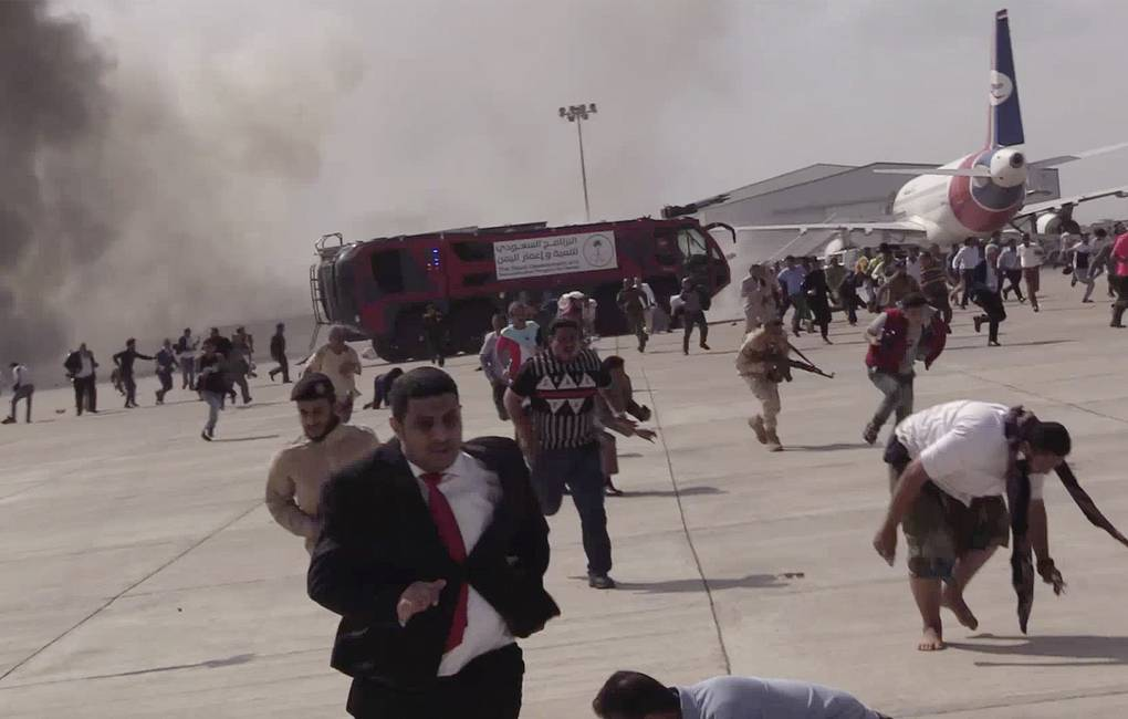 People running after the blasts rocked the airport in Yemen's Aden AP Photo