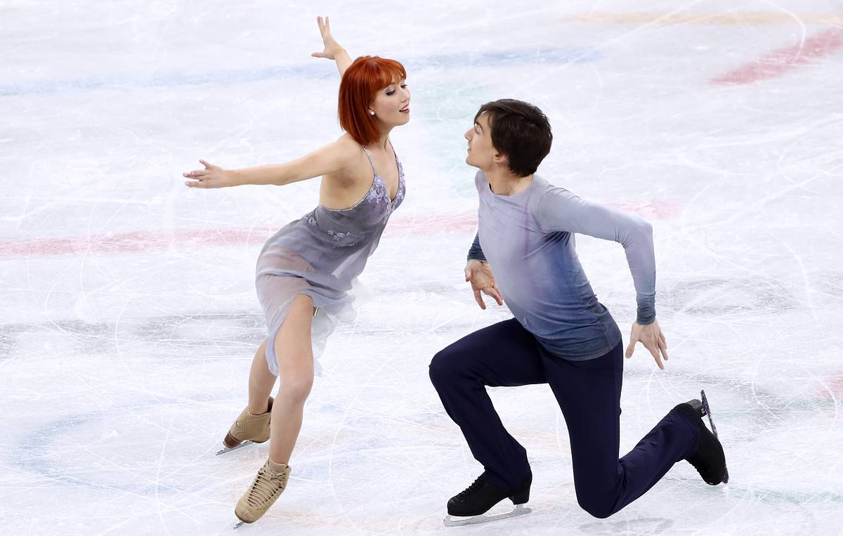 Skaters Zagorski and Gureyro begin to run a dance in the Grand Prix stage in Japan