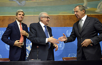 Lakhdar Brahimi, (C) UN Joint Special Representative for Syria, shakes hands with Sergei Lavrov, (R) Russian Foreign Minister, next to John Kerry, (L) US Secretary of State