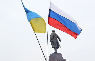 Ukrainian and Russian flags seen in Kharkiv