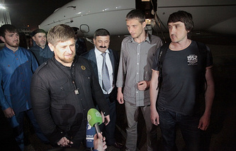Chechen leader Ramzan Kadyrov (left) accompanied by Russian journalists Oleg Sidyakin  (second right) and Marat Saichenko (right)